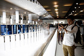 An attendee photographs a display of new Galaxy S6 smartphone devices following its launch at a Samsung Electronics Co news conference ahead of the...