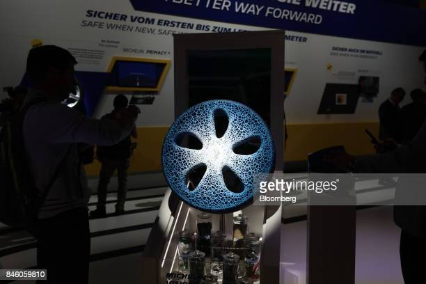 An attendee photographs a Michelin Visionary Concept 3D printed concept tire on the Michelin Cie stand during the first media preview day of the IAA...