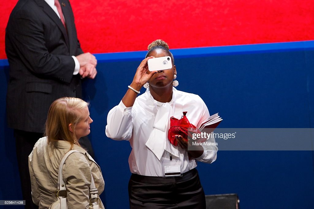An attendee photographs the auditorium setting of the Vice Presidential Debate folowing the event with Vice President Joe Biden and Paul Ryan at...