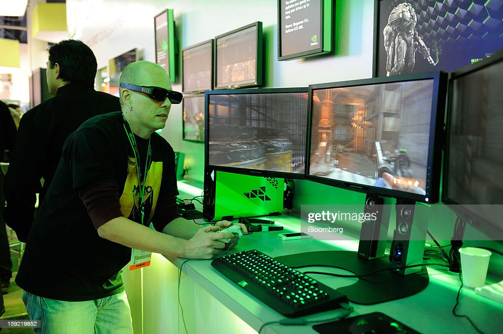 An attendee plays a 3D video game at the Nvidia Corp. booth at the 2013 Consumer Electronics Show in Las Vegas, Nevada, U.S., on Wednesday, Jan. 9, 2013. The 2013 CES trade show, which runs until Jan. 11, is the world's largest annual innovation event that offers an array of entrepreneur focused exhibits, events and conference sessions for technology entrepreneurs. Photographer: David Paul Morris/Bloomberg via Getty Images