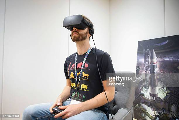 An attendee plays a game on an Oculus Rift virtual reality headset during the E3 Electronic Entertainment Expo in Los Angeles California US on...