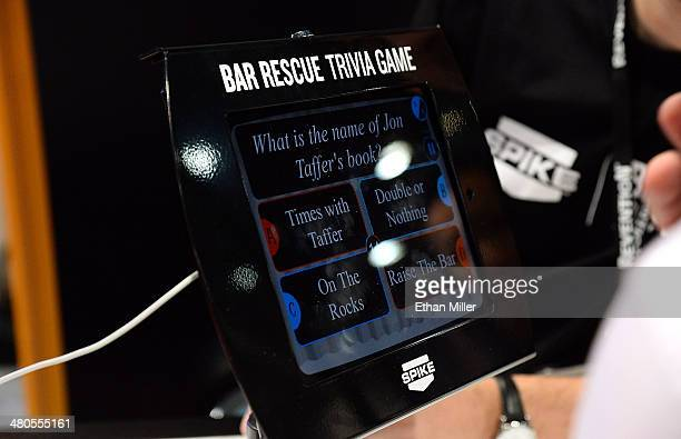 An attendee plays a trivia game at the Spike TV/'Bar Rescue' booth at the 29th annual Nightclub Bar Convention and Trade Show at the Las Vegas...