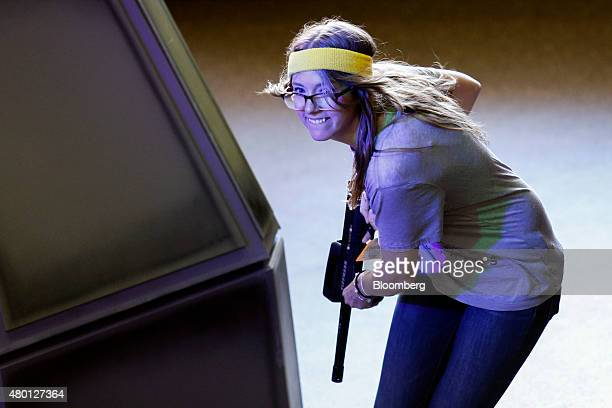 An attendee plays laser tag during a simulation of TakeTwo Interactive Software Inc's Battleborn video game at the ComicCon International convention...
