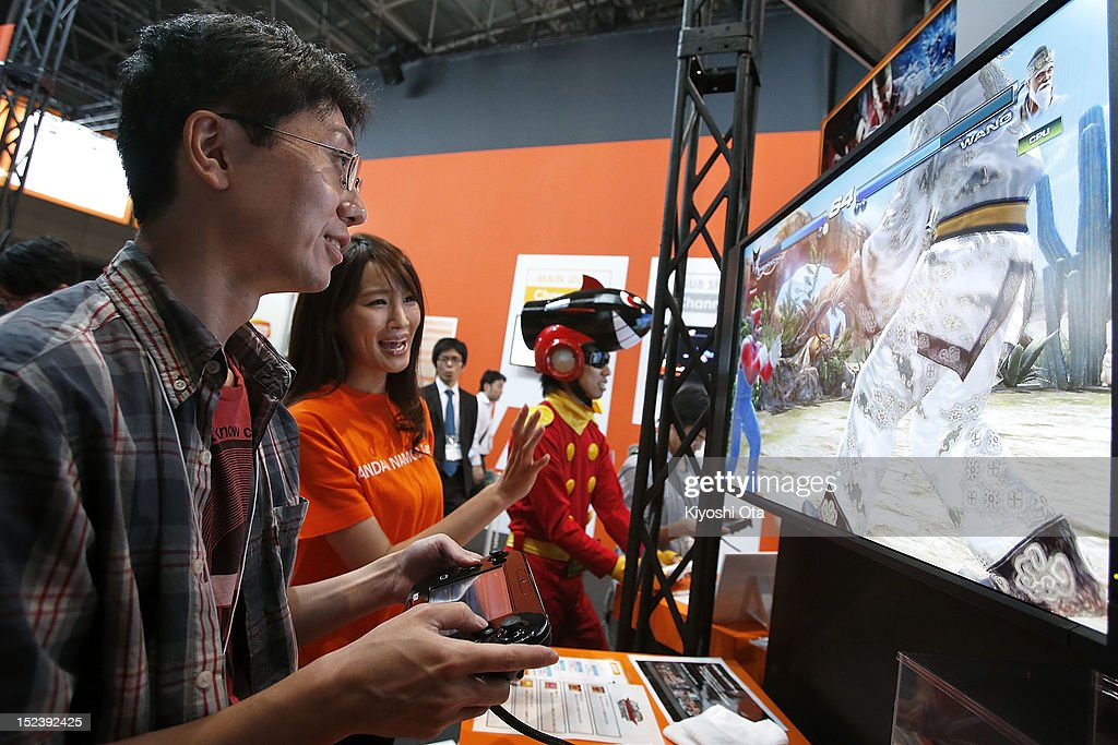 An attendee (L) plays Namco Bandai Games Inc.'s 'Tekken Tag Tournament 2' with Nintendo Co.'s Wii U video game console during the Tokyo Game Show 2012 at Makuhari Messe on September 20, 2012 in Chiba, Japan. The annual video game expo, which is held from September 20 to 23, attracts thousands of business visitors and the general public with exhibitions of the upcoming game software and latest hardware.