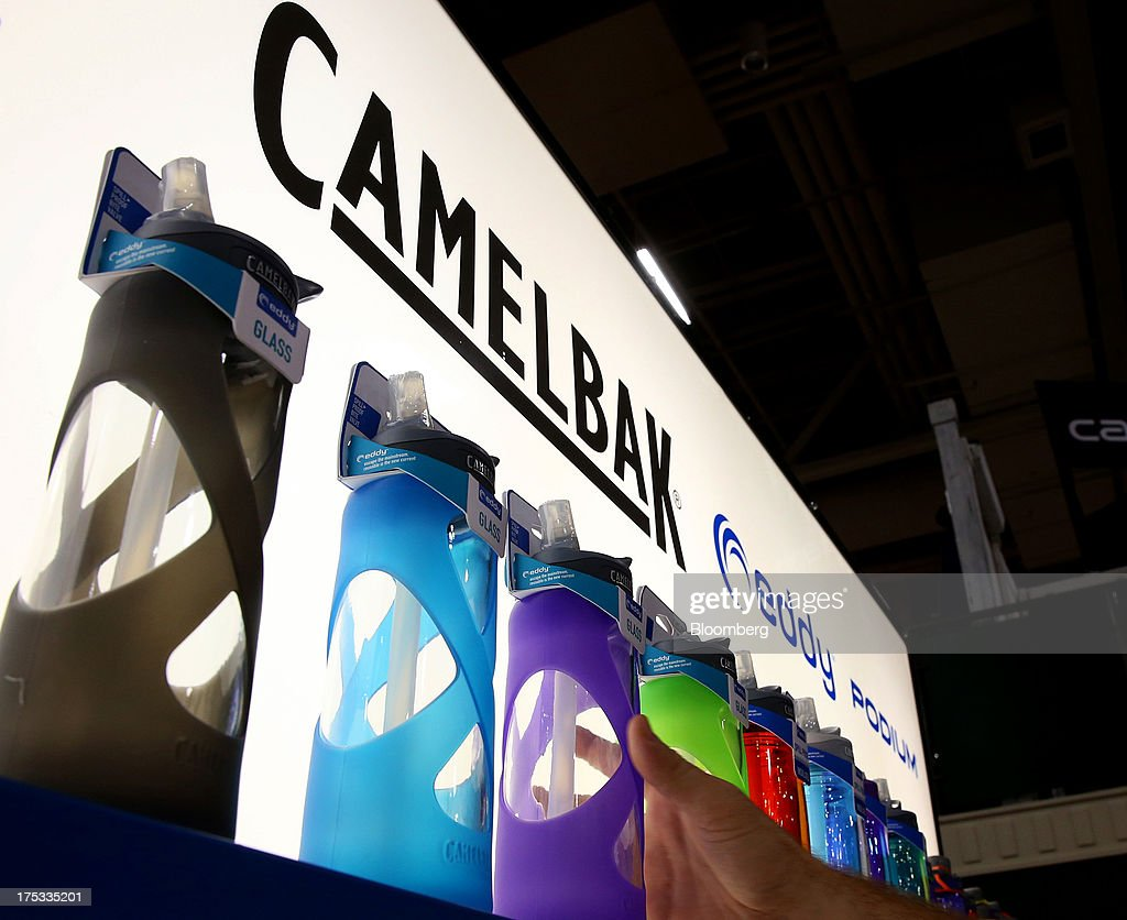 An attendee reaches for a CamelBak Products LLC bottle at the company's booth during the Outdoor Retailer Summer Market show in Salt Lake City, Utah, U.S., on Thursday, Aug. 1, 2013. Consumer spending in the U.S. rose in line with forecasts in June as Americans' incomes grew, a sign the biggest part of the economy is withstanding fiscal headwinds. Photographer: George Frey/Bloomberg via Getty Images