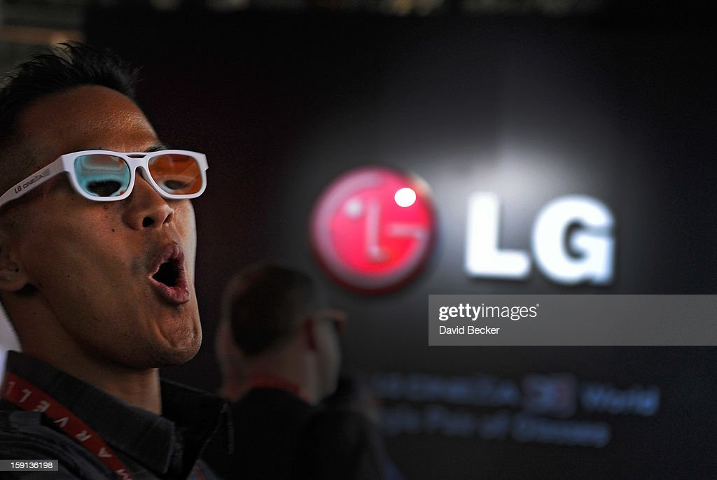 An attendee reacts to the 3D projection at the LG booth at the 2013 International CES at the Las Vegas Convention Center on January 8, 2013 in Las Vegas, Nevada. CES, the world's largest annual consumer technology trade show, runs through January 11 and is expected to feature 3,100 exhibitors showing off their latest products and services to about 150,000 attendees.