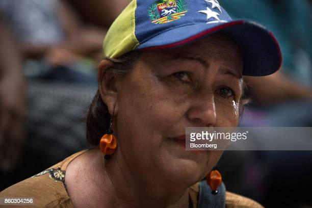 An attendee reacts while Henrique Capriles opposition leader and governor of the State of Miranda not pictured speaks during an event marking his...
