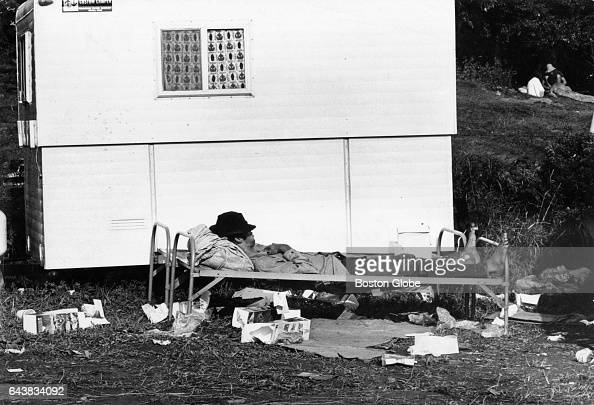 An attendee reclines on a cot at the Woodstock Music Festival in White Lake NY on Aug 17 1969