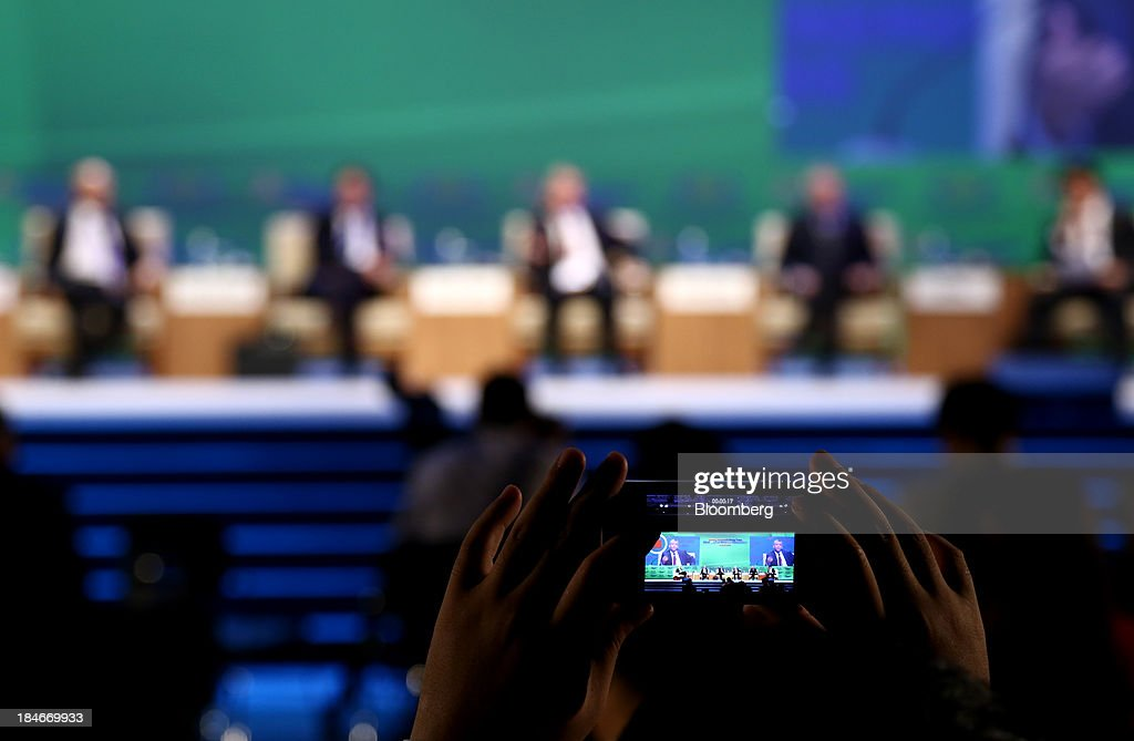 An attendee records a video using a mobile device at the 22nd World Energy Congress in Daegu South Korea on Tuesday Oct 15 2013 The WEC a global...