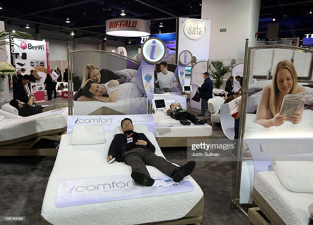 An attendee rests on a Sealy iComfort bed during the 2013 International CES at the Las Vegas Hilton on January 9, 2013 in Las Vegas, Nevada. CES, the world's largest annual consumer technology trade show, runs through January 11 and is expected to feature 3,200 exhibitors showing off their latest products and services to about 150,000 attendees.
