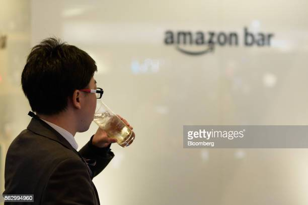 An attendee sips a drink at the Amazon Bar operated by Amazon Japan KK during a media preview in Tokyo Japan on Thursday Oct 19 2017 For 10 days the...