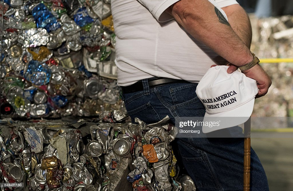 An attendee sits on a stack of crushed aluminum cans before the start of a campaign event with Donald Trump, presumptive Republican presidential nominee, not pictured, in Monessen, Pennsylvania, U.S., on Tuesday, June 28, 2016. President Barack Obama said Trump is a lifetime member of the 'global elite' who is trying to stir up in the U.S. the kind of anti-immigrant sentiment that drove Britain to vote itself out of the European Union. Photographer: Ty Wright/Bloomberg via Getty Images