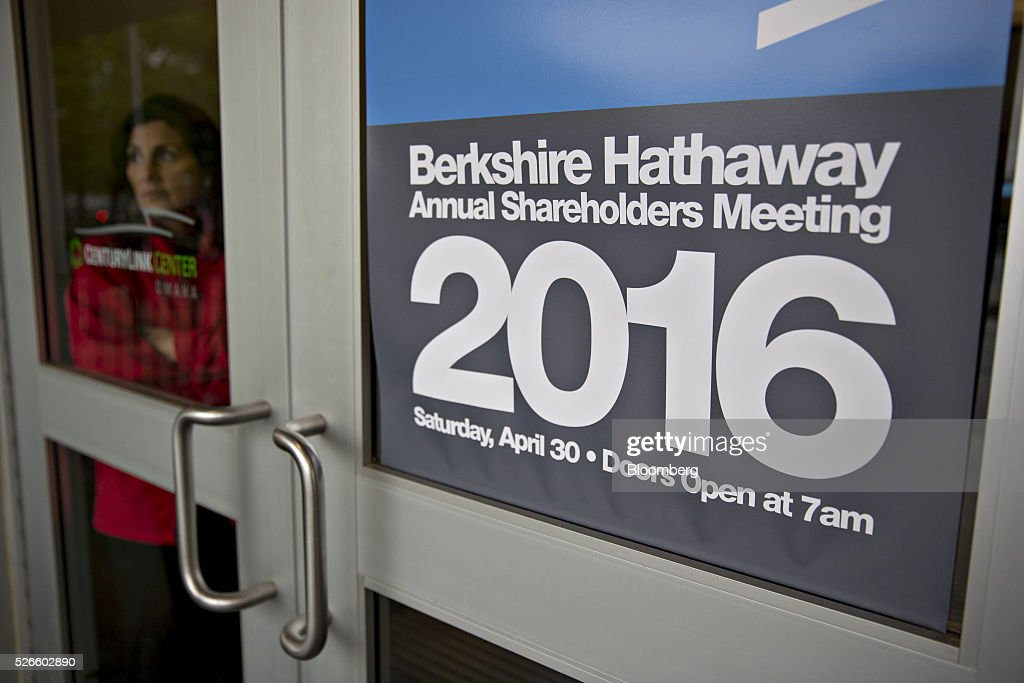 An attendee stands inside an entrance door to the Berkshire Hathaway Inc. annual shareholders meeting in Omaha, Nebraska, U.S., on Saturday, April 30, 2016. Dozens of Berkshire Hathaway Inc. subsidiaries will be showing off their products as Chief Executive Officer Warren Buffett hosts the company's annual meeting. Photographer: Daniel Acker/Bloomberg via Getty Images