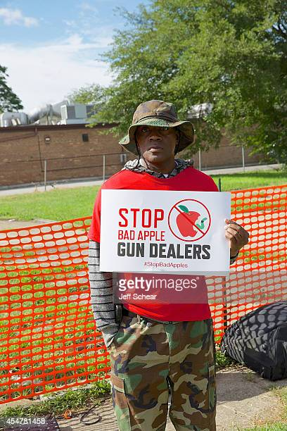 An attendee supporting the Brady Campaign 'Bad Apple' cause holds up a sign at the Brady Campaign 'Bad Apple' Gun Dealer Press Conference and Rally...