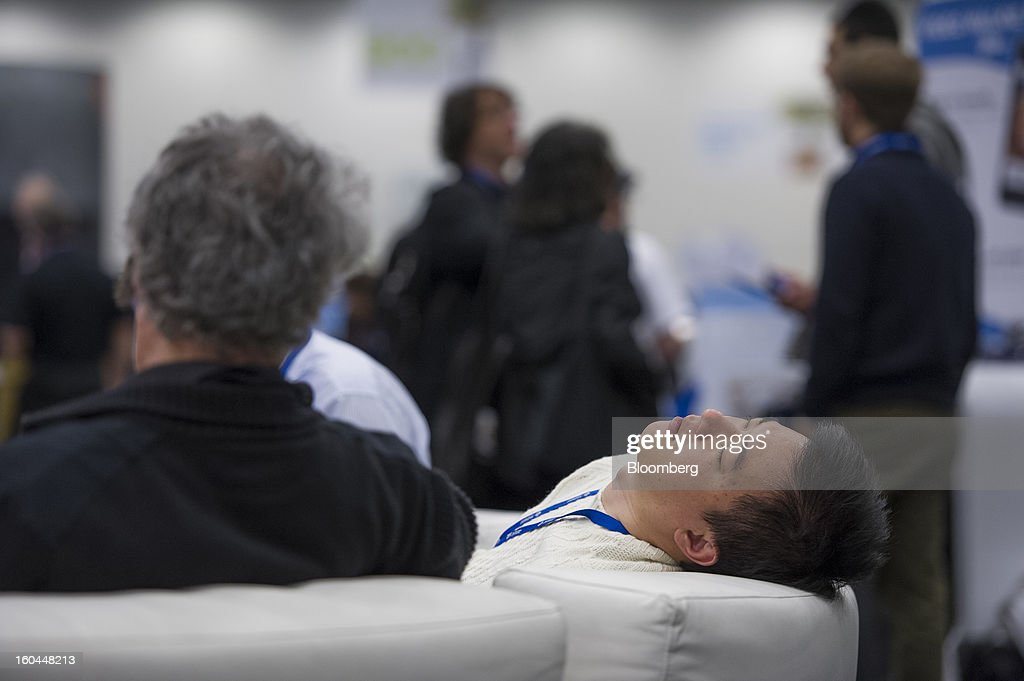 An attendee takes a nap at the Macworld/iWorld conference at the Moscone Center West in San Francisco, California, U.S., on Thursday, Jan. 31, 2013. This year's conference, titled 'The Ultimate iFANEvent,' brings together attendees to celebrate Apple Inc. technology and learn more about products and services for Apple users. Photographer: David Paul Morris/Bloomberg via Getty Images