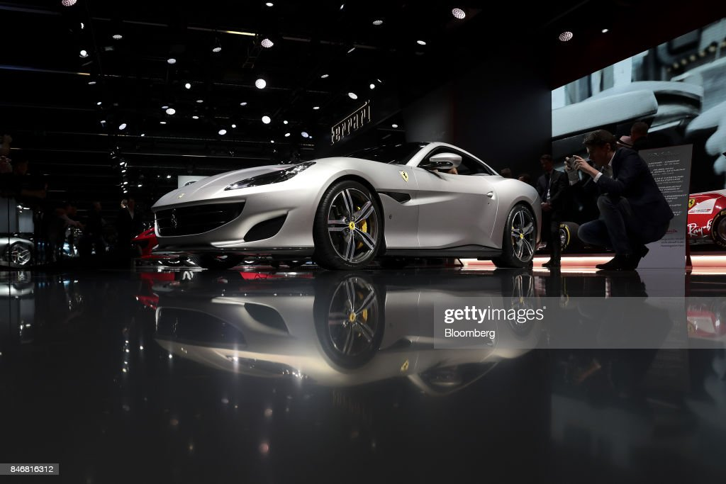 An attendee takes a photo of a Ferrari NV Portofino entry-level supercar sits on display during the second media preview day of the IAA Frankfurt Motor Show in Frankfurt, Germany, on Wednesday, Sept. 13, 2017. The 67th IAA opens to the public on Sept. 14 and features must-have vehicles and motoring technology from over 1,000 exhibitors in a space equivalent to 33 soccer fields. Photographer: Simon Dawson/Bloomberg via Getty Images