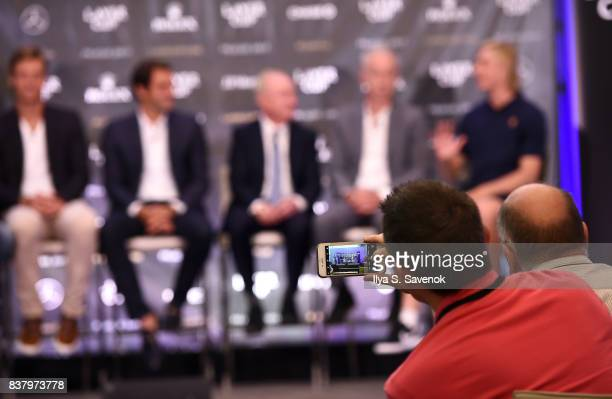 An attendee takes a photo of Tomas Berdych Roger Federer Rod Laver John McEnroe and Denis Shapovalov attend Laver Cup Team Announcement on August 23...