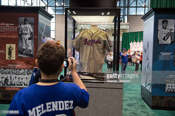 An attendee takes a picture of a Negro League jersey on the Opening Day of TMobile AllStar FanFest at the Jacob K Javits Convention Center on Friday...