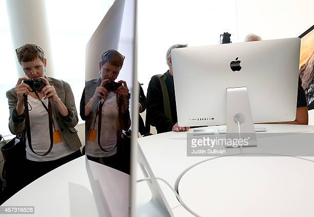 An attendee takes a picture of the new 27 inch iMac with 5K retina display during an Apple special event on October 16 2014 in Cupertino California...