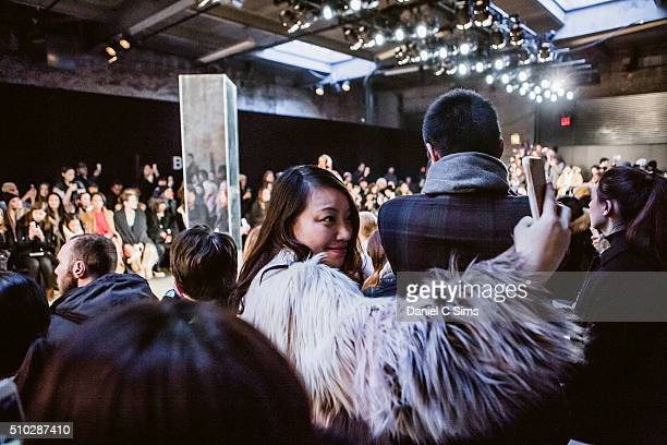 An attendee takes a selfie at the Sally LaPointe show at the Fall 2016 New York Fashion Week on February 14 2016 in New York City