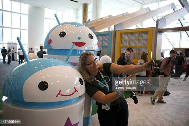 An attendee takes a selfie in front of Android mascots during the 2015 Google I/O conference on May 28 2015 in San Francisco California The annual...