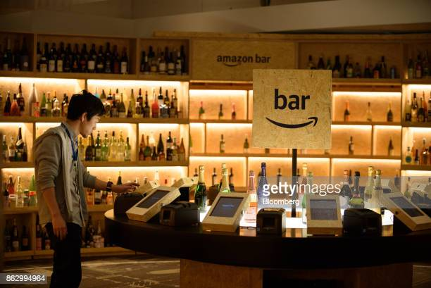 An attendee takes a ticket after ordering a drink at the Amazon Bar operated by Amazon Japan KK during a media preview in Tokyo Japan on Thursday Oct...