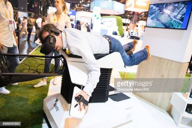 An attendee tests a body flight simulator during Viva Technology at Parc des Expositions Porte de Versailles on June 16 2017 in Paris France Viva...