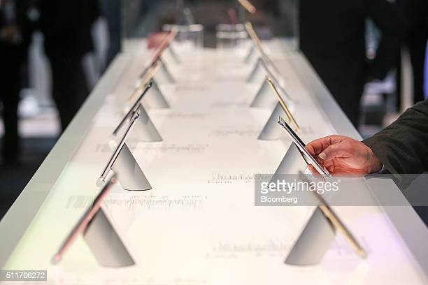 An attendee tests a smartphone on the HTC Corp display stand at the Mobile World Congress in Barcelona Spain on Monday Feb 22 2016 Mobile World...