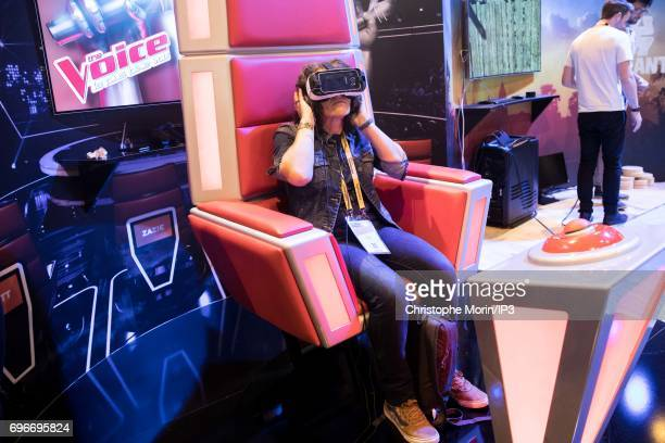 An attendee tests a virtual reality headset by The Voice during Viva Technology at Parc des Expositions Porte de Versailles on June 16 2017 in Paris...