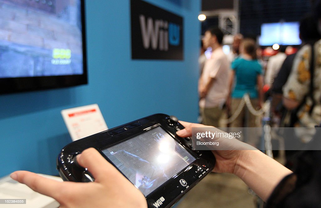 An attendee tries a Nintendo Co. Wii U game console at the Tokyo Game Show 2012 at Makuhari Messe in Chiba, Japan, on Thursday, Sept. 20, 2012. The show will be held through Sept. 23. Photographer: Tomohiro Ohsumi/Bloomberg via Getty Images