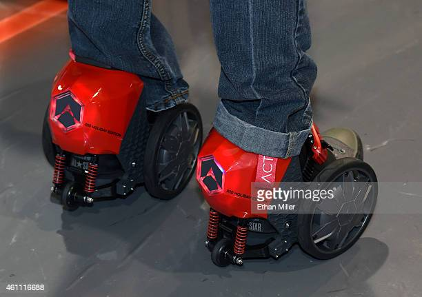 An attendee tries Acton's RocketSkates at the 2015 International CES at the Sands Expo and Convention Center on January 6 2015 in Las Vegas Nevada...