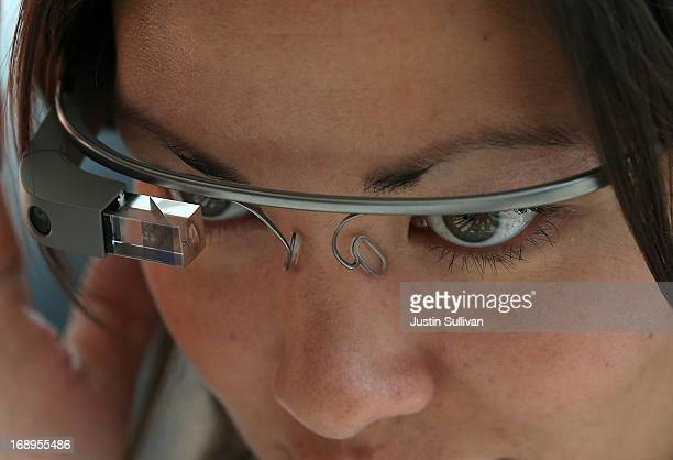 An attendee tries Google Glass during the Google I/O developer conference on May 17 2013 in San Francisco California Eight members of the...