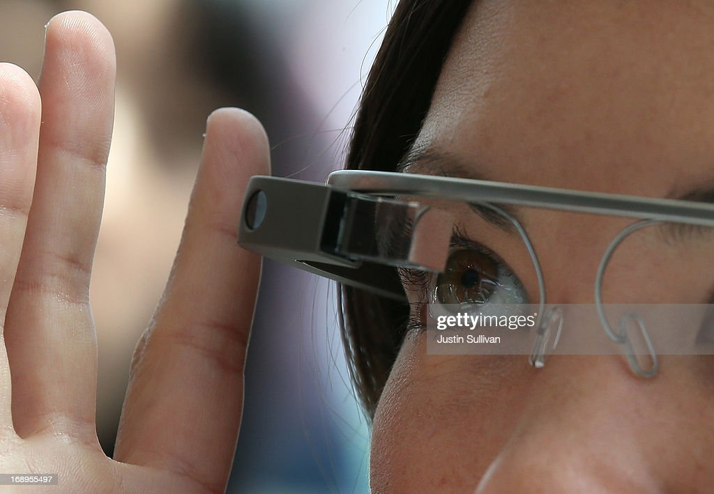 An attendee tries Google Glass during the Google I/O developer conference on May 17, 2013 in San Francisco, California. Eight members of the Congressional Bi-Partisan Privacy Caucus sent a letter to Google co-founder and CEO Larry Page seeking answers to privacy questions and concerns surrounding Google's photo and video-equipped glasses called 'Google Glass'. The panel wants to know if the high tech eyeware could infringe on the privacy of Americans. Google has been asked to respond to a series of questions by June 14.