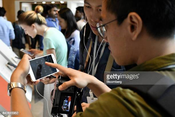 An attendee tries out a Xiaomi Corp Mi A1 dual camera device during the smartphone's launch in New Delhi India on Tuesday Sept 5 2017 Google is...