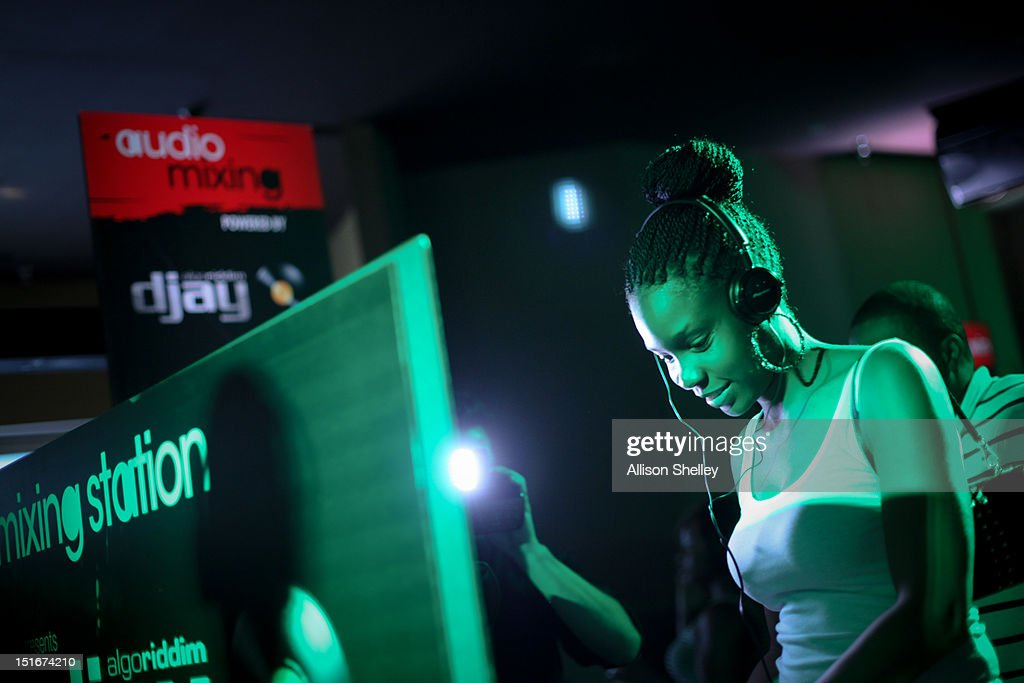 An attendee tries out the audio mixing station at Heineken Red Star Access D.C. featuring B.o.B. and DJ Ruckus on September 8, 2012 in Washington, D.C.