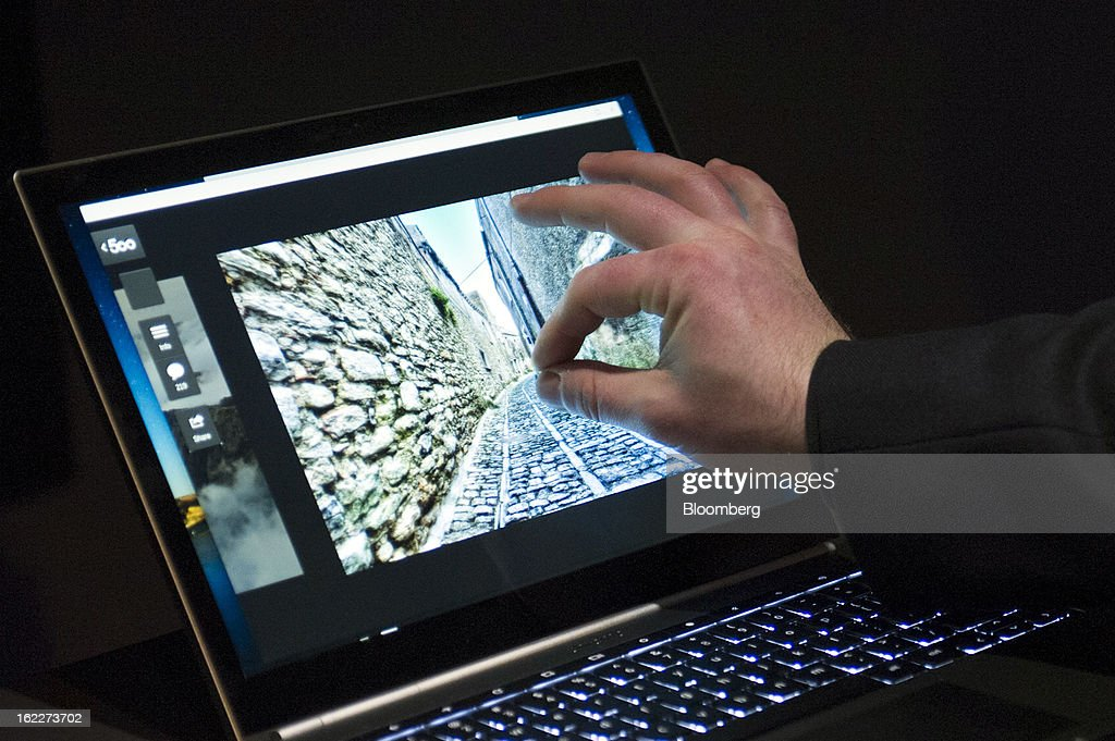 An attendee tries out the new Google Inc. Chromebook Pixel laptop during a launch event in San Francisco, California, U.S., on Thursday, Feb. 21, 2013. Google Inc., owner of the world's most popular search engine, debuted a touchscreen version of the Chromebook laptop, stepping up its challenge to Microsoft Corp. and Apple Inc. in hardware. Photographer: David Paul Morris/Bloomberg via Getty Images