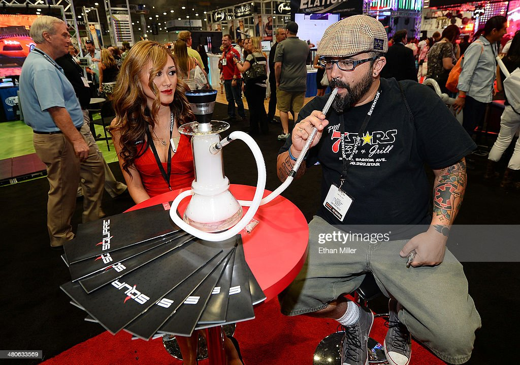 An attendee tries products at the Square electronic cigarette booth at the 29th annual Nightclub & Bar Convention and Trade Show at the Las Vegas Convention Center on March 25, 2014 in Las Vegas, Nevada.