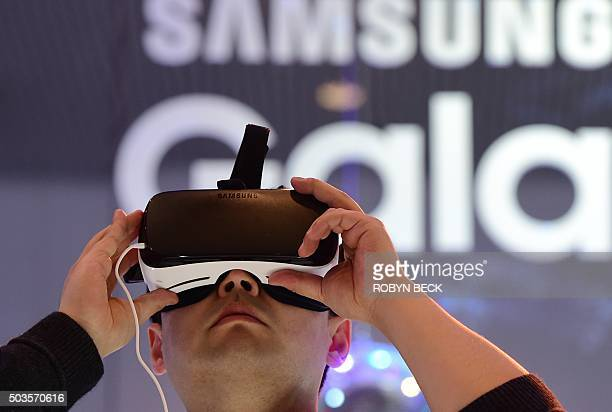 An attendee tries the Samsung Gear VR virtual reality headset at the Las Vegas Convention Center January 5 2016 in Las Vegas Nevada ahead of the CES...