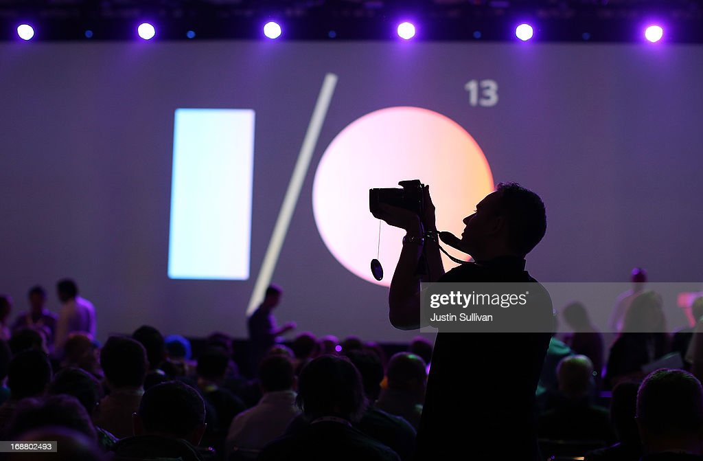 An attendee uses a camera to take pictures before the start of the opening keynote at the Google I/O developers conference at the Moscone Center on May 15, 2013 in San Francisco, California. Thousands are expected to attend the 2013 Google I/O developers conference that runs through May 17.