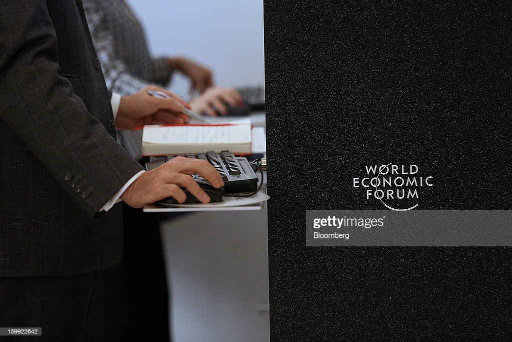 An attendee uses a computer on the opening day of the World Economic Forum (WEF) in Davos, Switzerland, on Wednesday, Jan. 23, 2013. World leaders, Influential executives, bankers and policy makers attend the 43rd annual meeting of the World Economic Forum in Davos, the five day event runs from Jan. 23-27. Photographer: Chris Ratcliffe/Bloomberg via Getty Images