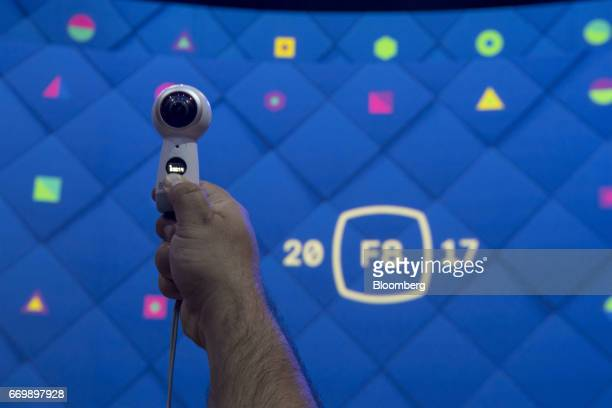 An attendee uses a Samsung Electronics Co Gear 360 camera before the beginning of a keynote address during the F8 Facebook Developer Conference in...