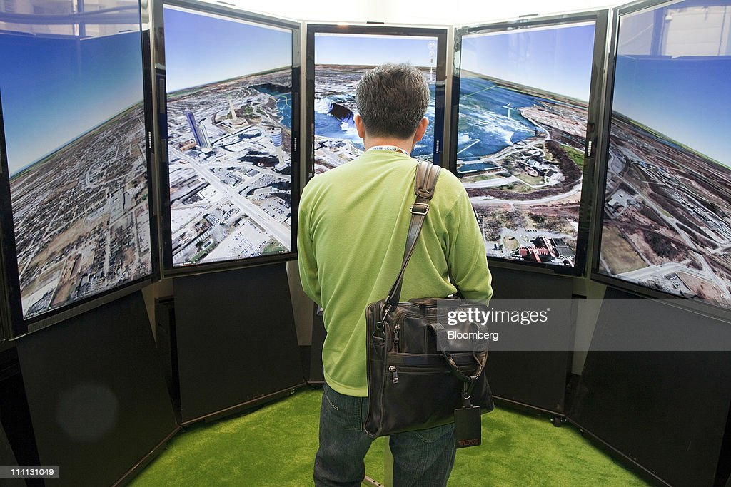 An attendee uses the Google Earth booth during the Google I/O conference in San Francisco, California, U.S., on Wednesday, May 11, 2011. Google Inc., the world's largest Internet-search company, is making a bigger push into entertainment services, adding music storage and movie-rental features to its Android software for phones and tablets. Photographer: David Paul Morris/Bloomberg via Getty Images