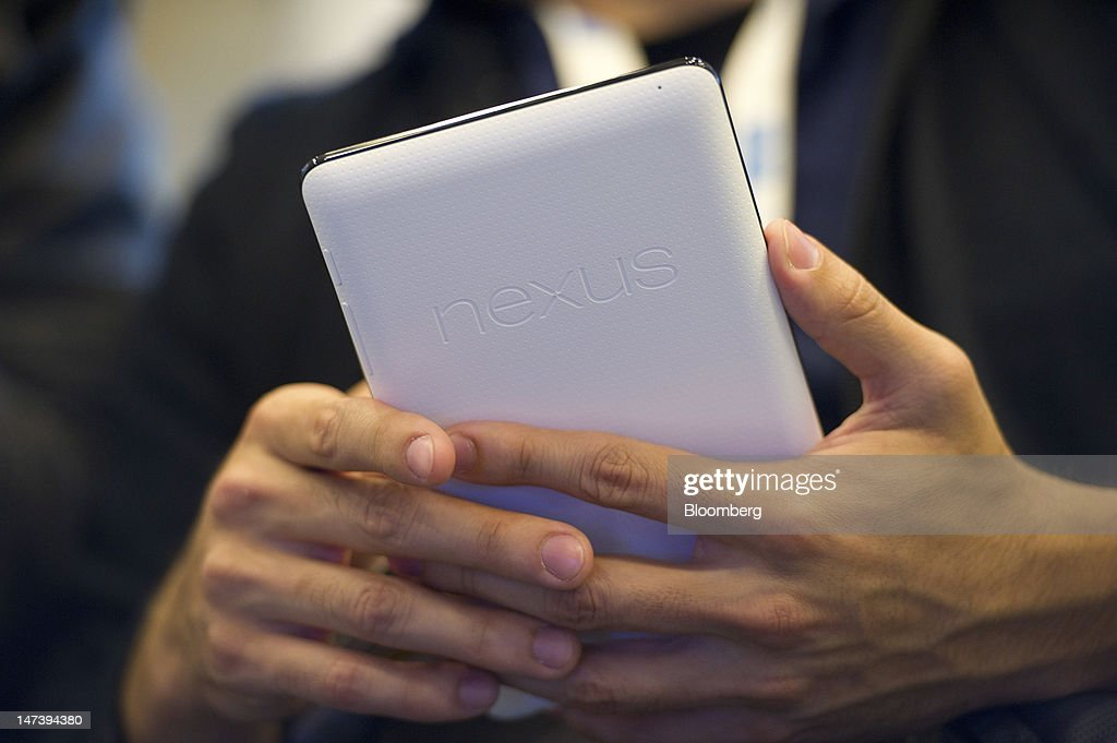 An attendee uses the new Google Inc. Nexus 7 tablet during the Google I/O conference in San Francisco, California, U.S., on Thursday, June 28, 2012. Google Inc., owner of the world's most popular search engine, unveiled a cloud-computing service for building and running applications to help woo customers and challenge Amazon.com Inc.'s Web Services. Photographer: David Paul Morris/Bloomberg via Getty Images
