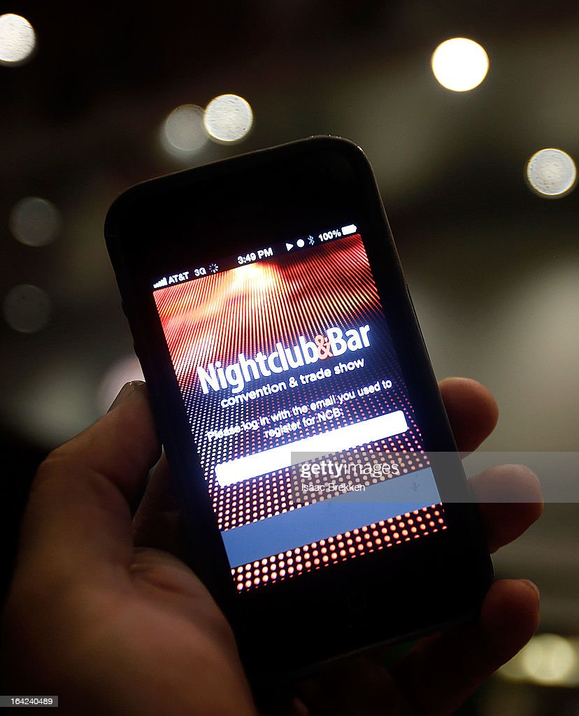 An attendee uses the Nightclub & Bar application during the 28th annual Nightclub & Bar Convention and Trade Show at the Las Vegas Convention Center on March 21, 2013 in Las Vegas, Nevada.
