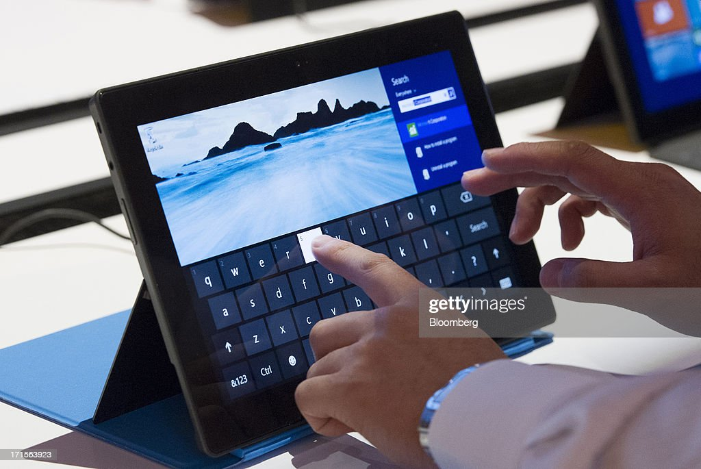 An attendee uses the touch screen on Microsoft Corp.'s Surface computer tablet during the Microsoft Corp. Build Developers Conference in San Francisco, California, U.S., on Wednesday, June 26, 2013. Facebook Inc. is building an application for Microsoft Corp.'s Windows 8, adding one of the most popular programs still missing from the operating system designed to help Microsoft gain tablet customers. Photographer: David Paul Morris/Bloomberg via Getty Images