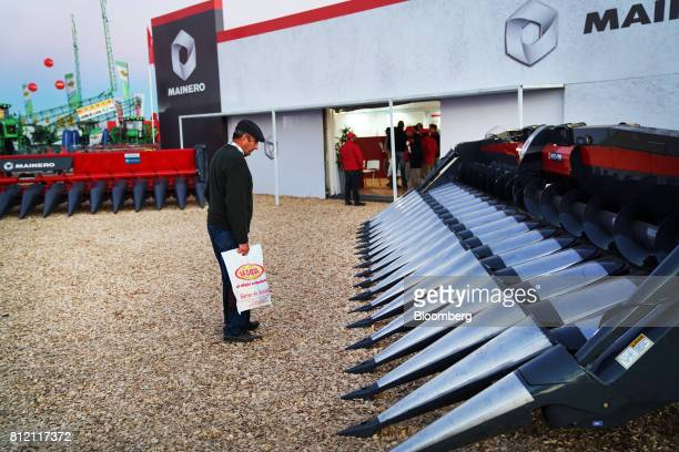 An attendee views a Carlos Mainero y Cia Saicfi MDD100 Row Independent corn header during the AgroActiva fair in Armstrong Santa Fe Argentina on...