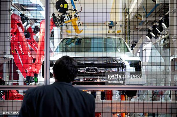 An attendee views a Ford Motor Co F150 pickup truck on a mock assembly line during the 2014 North American International Auto Show in Detroit...