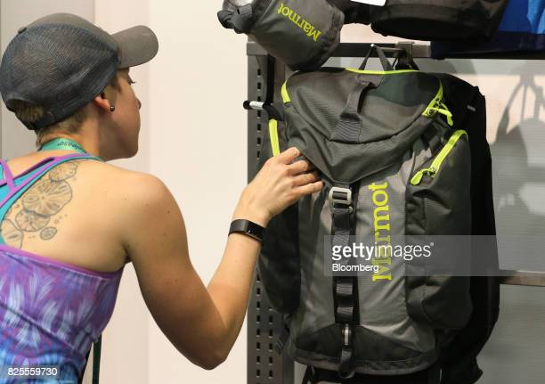 An attendee views a Marmot Mountain LLC backpack on display during the Outdoor Retailer Summer Market Show in Salt Lake City Utah US on Saturday July...
