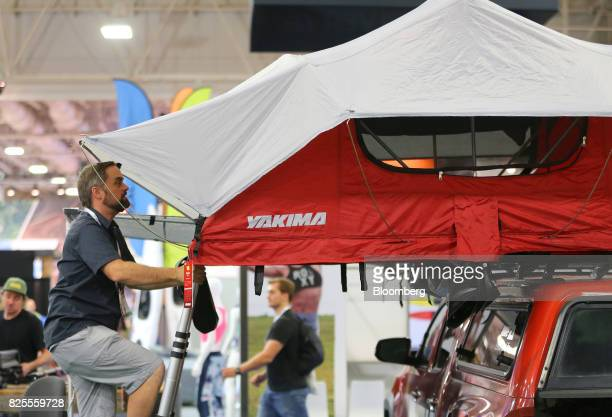 An attendee views a Yakima Products Inc tent on display during the Outdoor Retailer Summer Market Show in Salt Lake City Utah US on Saturday July 29...