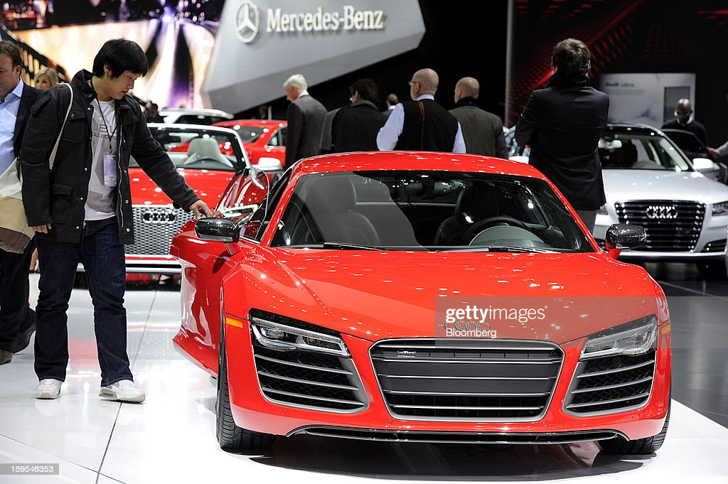An attendee views an Audi AG RS 5 vehicle during the 2013 North American International Auto Show (NAIAS) in Detroit, Michigan, U.S., on Tuesday, Jan. 15, 2013. The Detroit auto show runs through Jan. 27 and will display over 500 vehicles, representing the most innovative designs in the world. Photographer: David Paul Morris/Bloomberg via Getty Images